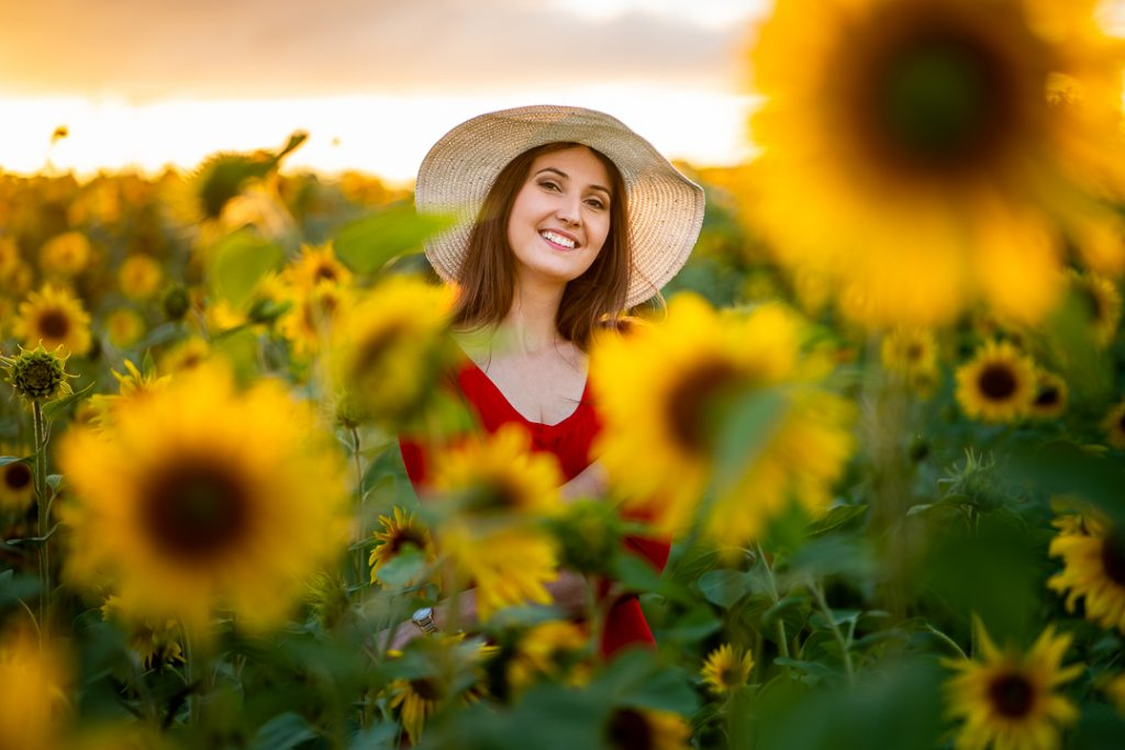 Latvian travel blogger sunflower field